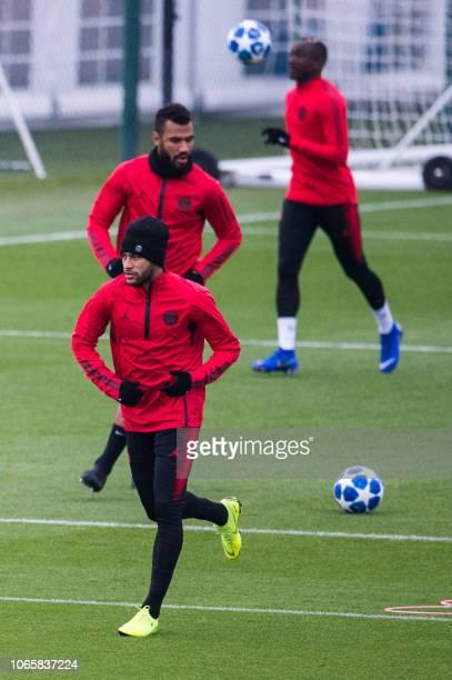 Paris SaintGermain's Brazilian forward Neymar runs as he takes part with teammates Cameroonian forward EricMaxim ChoupoMoting and French forward...