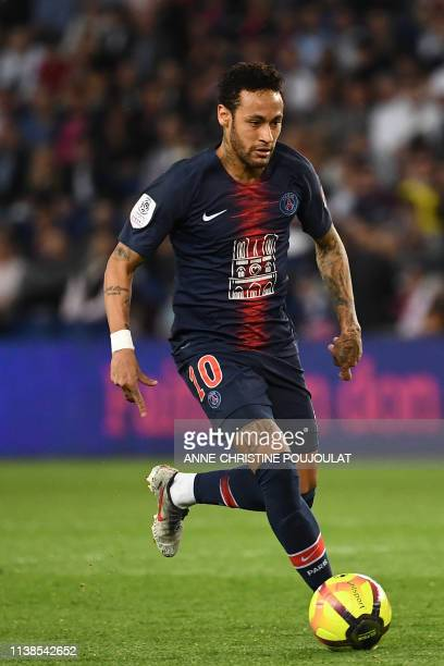 Paris SaintGermain's Brazilian forward Neymar runs with the ball during the French L1 football match between Paris SaintGermain and Monaco on April...