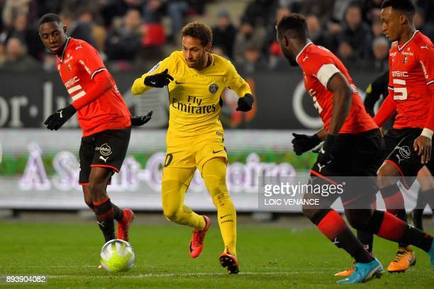 Paris SaintGermain's Brazilian forward Neymar runs with the ball during the French L1 football match between Rennes and Paris Saint Germain on...