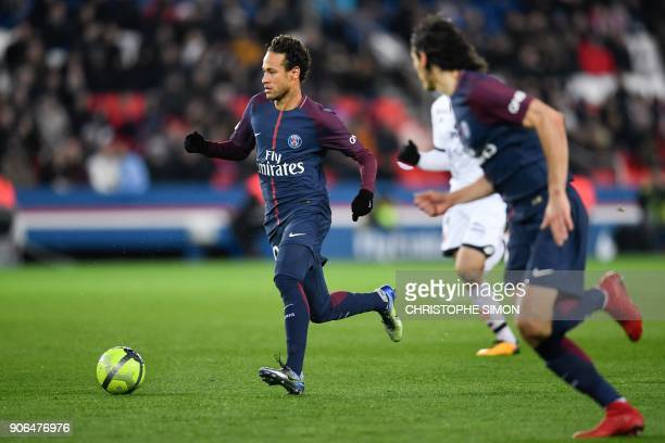 Paris SaintGermain's Brazilian forward Neymar runs with the ball during the French L1 football match between Paris SaintGermain and Dijon on January...