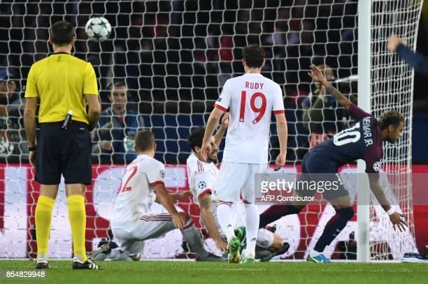 Paris SaintGermain's Brazilian forward Neymar scores a goal during the UEFA Champions League football match between Paris SaintGermain and Bayern...