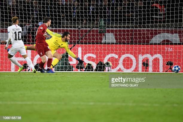 Paris SaintGermain's Brazilian forward Neymar scores past Liverpool's Brazilian goalkeeper Alisson during the UEFA Champions League Group C football...