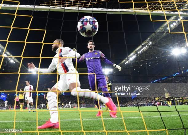 Paris Saint-Germain's Brazilian forward Neymar scores the 1-1 goal past Dortmund's Swiss goalkeeper Roman Buerki during the UEFA Champions League...