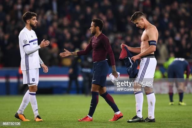 Paris SaintGermain's Brazilian forward Neymar shakes hands with Anderlecht's Portuguese defender Josue Sa after the UEFA Champions League Group B...