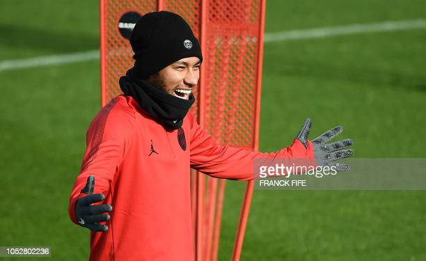 Paris SaintGermain's Brazilian forward Neymar shares a light moment with teammates as they take part in a training session of the Paris SaintGermain...