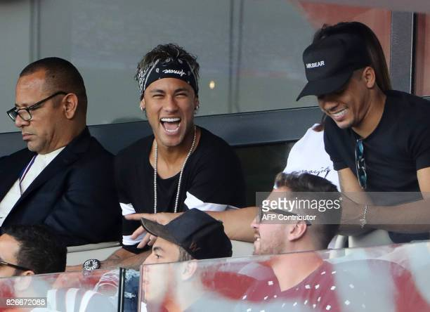 Paris SaintGermain's Brazilian forward Neymar shares a light moment with his close friend Jo Amancio as his father Neymar Santos and mother Nadine...