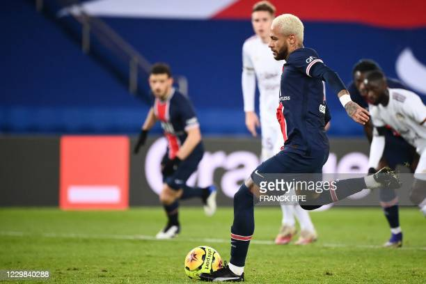 Paris Saint-Germain's Brazilian forward Neymar shoots and scores a penalty during the French L1 football match between Paris Saint-Germain and...