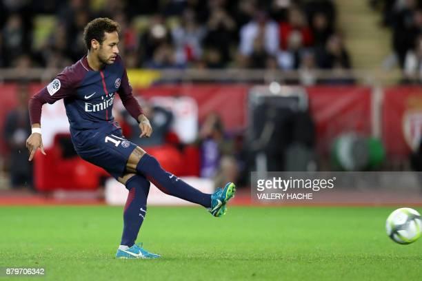 Paris SaintGermain's Brazilian forward Neymar shoots and scores a penalty kick during the French L1 football match between Monaco and Paris...