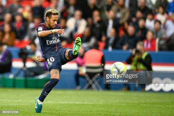 Paris SaintGermain's Brazilian forward Neymar shoots on goal during the French L1 football match Paris SaintGermain vs Bordeaux on September 30 2017...