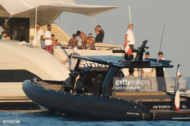 Paris SaintGermain's Brazilian forward Neymar sits at the back of a yacht after leaving a beach in Ramatuelle southeastern France on August 7 2017...