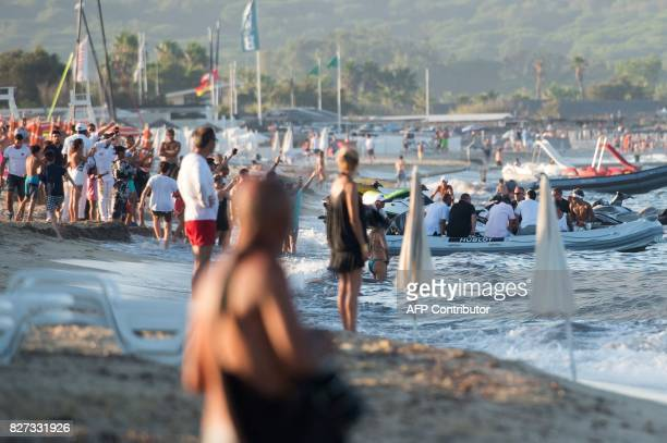Paris SaintGermain's Brazilian forward Neymar sits in a boat as he leaves a beach in Ramatuelle southeastern France on August 7 2017 two days after...