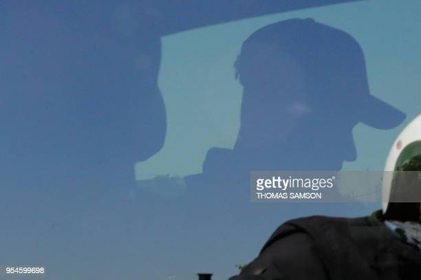Paris Saint-Germain's Brazilian forward Neymar sits in a vehicle after disembarking from a private jet on the tarmac of Le Bourget airport near Paris...