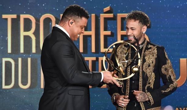 Paris Saint-Germain's Brazilian forward Neymar (R) smiles
