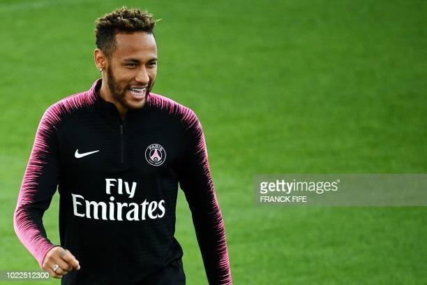 Paris SaintGermain's Brazilian forward Neymar smiles as he takes part in a training session of the Paris SaintGermain football team on August 24 2018...