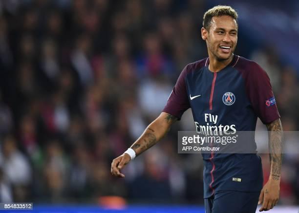 Paris SaintGermain's Brazilian forward Neymar smiles during the UEFA Champions League football match between Paris SaintGermain and Bayern Munich on...