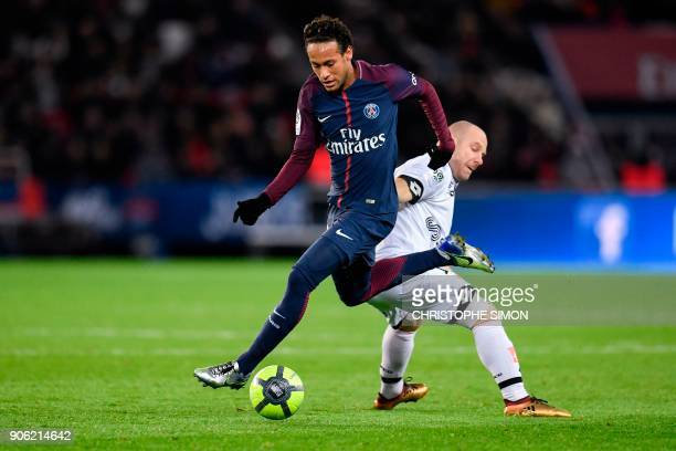 Paris SaintGermain's Brazilian forward Neymar snatches the ball from Dijon's French midfielder Florent Balmont during the French L1 football match...