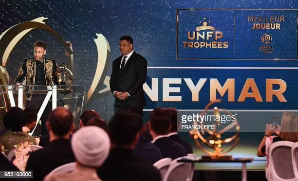Paris SaintGermain's Brazilian forward Neymar speaks as he receives the Best Ligue 1 Player award from former Brazilian international player Ronaldo...