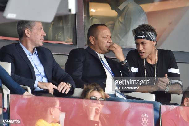 Paris SaintGermain's Brazilian forward Neymar speaks with his father Neymar Santos during the French L1 football match between Paris SaintGermain and...