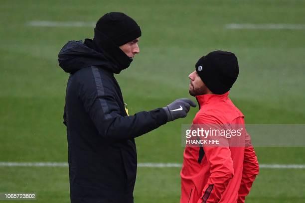 Paris SaintGermain's Brazilian forward Neymar speaks with Paris SaintGermain's German head coach Thomas Tuchel during a training session in...