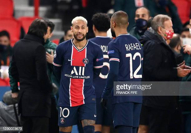 Paris Saint-Germain's Brazilian forward Neymar speaks with Paris Saint-Germain's Brazilian midfielder Rafinha during the UEFA Champions League group...