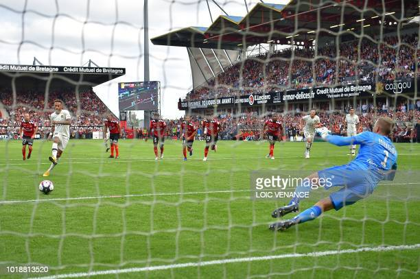TOPSHOT Paris SaintGermain's Brazilian forward Neymar takes a penalty kick to score the equalizer to Guingamp's Swedish goalkeeper KarlJohan Johnsson...