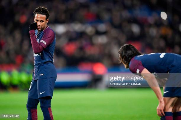 Paris SaintGermain's Brazilian forward Neymar talks to Paris SaintGermain's Uruguayan forward Edinson Cavani prior to shooting a freekick during the...