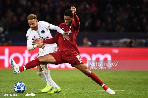 Paris SaintGermain's Brazilian forward Neymar vies for the ball with Liverpool's English defender Joe Gomez during the UEFA Champions League Group C...