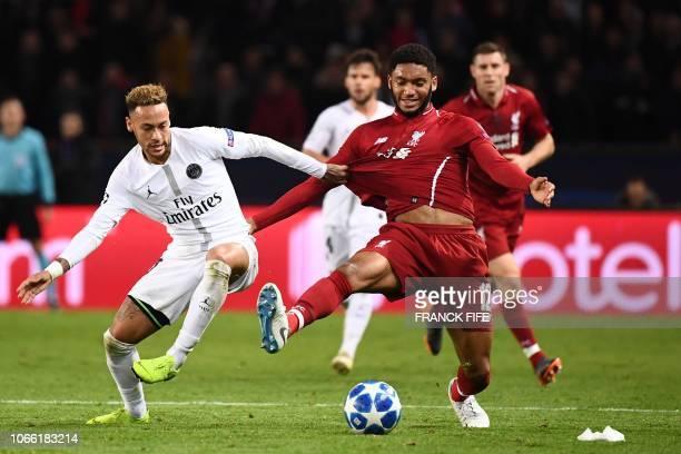 TOPSHOT Paris SaintGermain's Brazilian forward Neymar vies for the ball with Liverpool's English defender Joe Gomez during the UEFA Champions League...