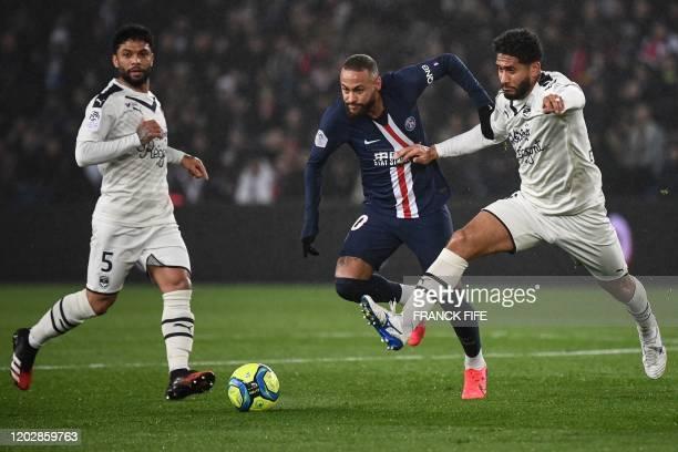 Paris Saint-Germain's Brazilian forward Neymar vies for the ball with Bordeaux's Brazilian defender Pablo Nascimento Castro and Bordeaux's Brazilian...