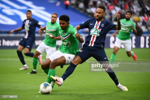 Paris Saint-Germain's Brazilian forward Neymar vies for the ball with Saint-Etienne's French defender Wesley Fofana during the French Cup final...