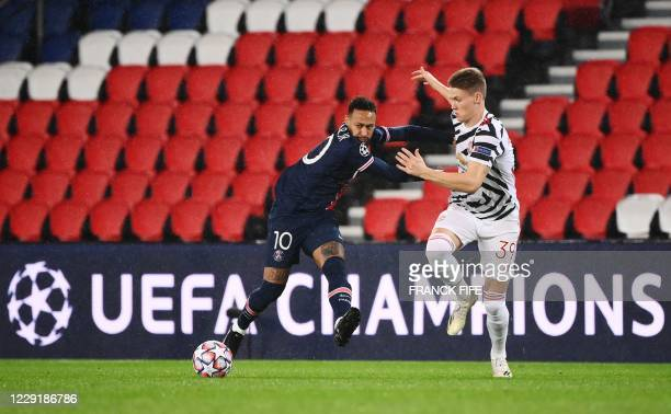 Paris SaintGermain's Brazilian forward Neymar vies for the ball with Manchester United's Scottish midfielder Scott McTominay during the UEFA...