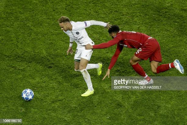 Paris SaintGermain's Brazilian forward Neymar vies vies for the ball with Liverpool's English defender Joe Gomez during the UEFA Champions League...