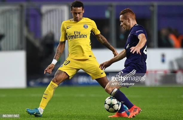 Paris SaintGermain's Brazilian forward Neymar vies with Anderlecht's French midfielder Adrien Trebel during the UEFA Champions League Group B...