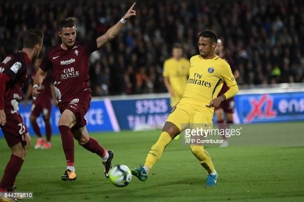 Paris SaintGermain's Brazilian forward Neymar vies with Metz's Luxembourgian defender Chris Philipps during the French L1 football match between Metz...