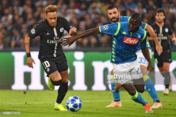 Paris SaintGermain's Brazilian forward Neymar vies with Napoli's Senegalese defender Kalidou Koulibaly during the European Champions League football...