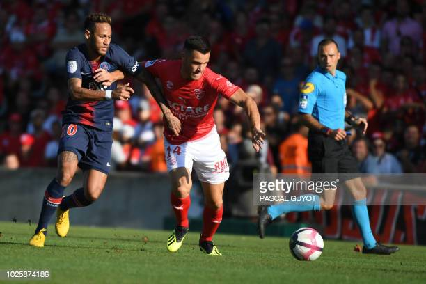 Paris SaintGermain's Brazilian forward Neymar vies with Nîmes' French midfielder Antonin Bobichon during the French L1 football match between Nimes...