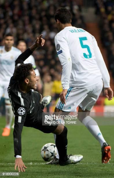 Paris SaintGermain's Brazilian forward Neymar vies with Real Madrid's French defender Raphael Varane during the UEFA Champions League round of...