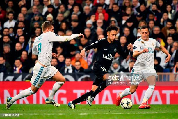 TOPSHOT Paris SaintGermain's Brazilian forward Neymar vies with Real Madrid's German midfielder Toni Kroos and Real Madrid's Spanish midfielder Lucas...