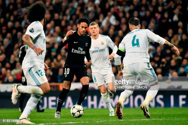Paris SaintGermain's Brazilian forward Neymar vies with Real Madrid's Brazilian defender Marcelo Real Madrid's German midfielder Toni Kroos and Real...