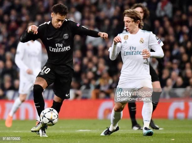 Paris SaintGermain's Brazilian forward Neymar vies with Real Madrid's Croatian midfielder Luka Modric during the UEFA Champions League round of...