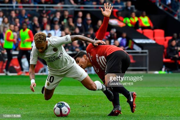 Paris SaintGermain's Brazilian forward Neymar vies with Rennes' French midfielder Benjamin Andre during the French L1 football match between Rennes...