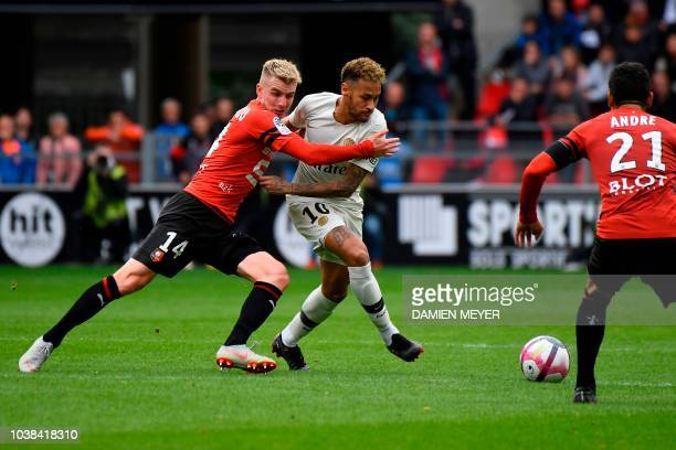 Paris SaintGermain's Brazilian forward Neymar vies with Rennes' French midfielder Benjamin Bourigeaud during the French L1 football match between...
