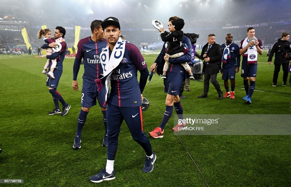 Paris Saint-Germain's Brazilian forward Neymar walks on the pitch as he celebrates after winning the French L1 title at the end of the French L1 football match Paris Saint-Germain (PSG) vs Rennes on May 12, 2018 at the Parc des Princes stadium in Paris.