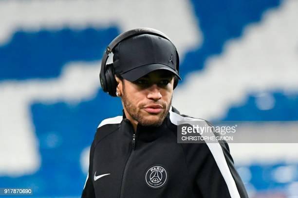 Paris SaintGermain's Brazilian forward Neymar walks on the pitch at the Santiago Bernabeu stadium in Madrid on February 13 2018 on the eve of the...