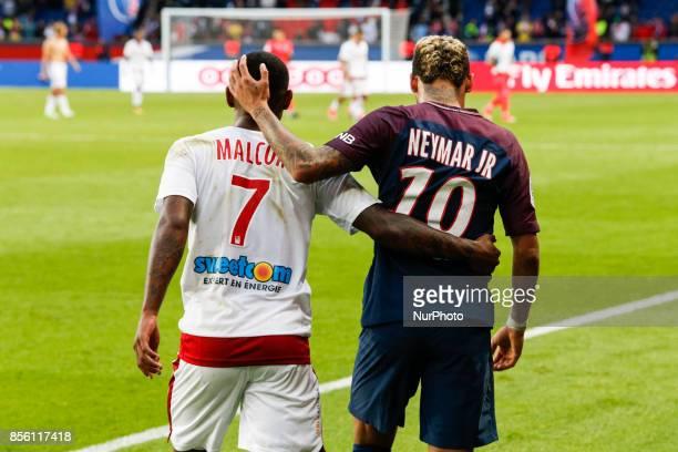 Paris SaintGermain's Brazilian forward Neymar with Bordeaux's Brazilian forward Malcom at the end of the French L1 football match between Paris...
