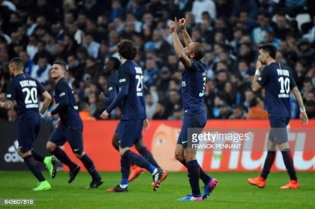 Paris Saint-Germain's Brazilian midfielder Lucas Moura celebrates after a goal during the French L1 football match Marseille vs Paris on February 26...