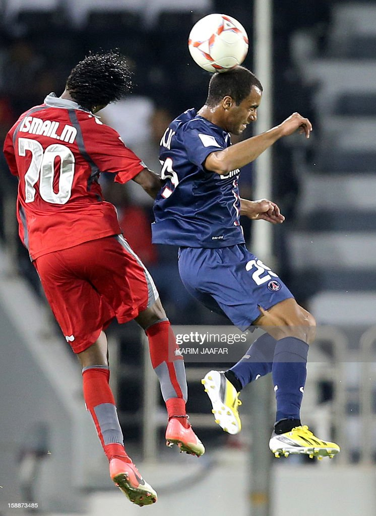Paris Saint-Germain's (PSG) Brazilian midfielder Lucas Moura (R) fights for the ball with Qatar's Lekhwiya player Ismail Mohammed during their friendly football match in Doha on January 2, 2013. PSG won 5-1.
