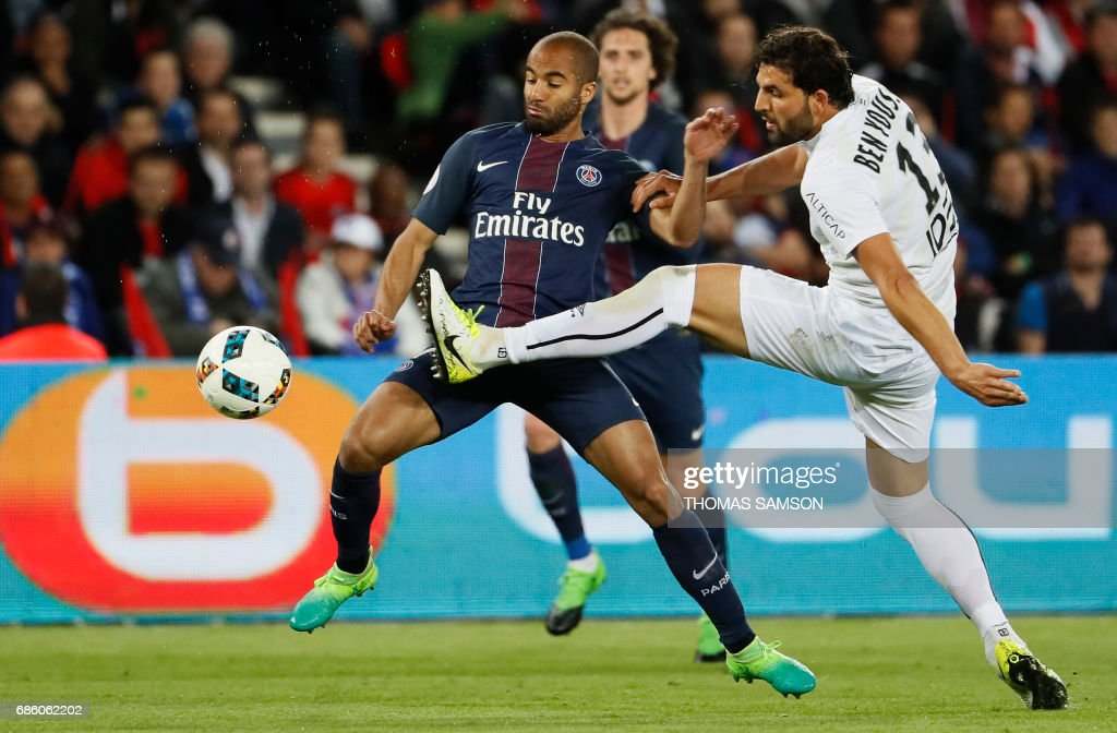 Paris Saint-Germain's Brazilian midfielder Lucas Moura (C) vies with Caen's French defender Syam Ben Youssef (R) during the French L1 football match between Paris Saint-Germain (PSG) and SM Caen on May 20, 2017 at the Parc des Princes stadium, in Paris. /