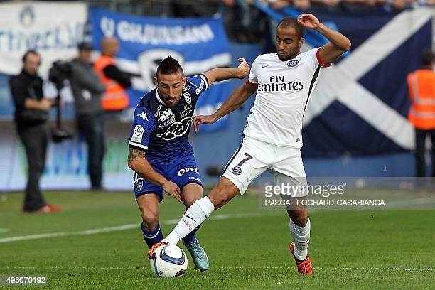Paris SaintGermain's Brazilian midfielder Lucas Moura vies with Bastia's French defender Julian Palmieri during the L1 football match Bastia against...