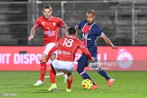 Paris Saint-Germain's Brazilian midfielder Rafinha drives the ball during the French L1 football match between Nimes and Paris Saint Germain at the...